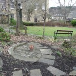 wildlife garden paving and peace cairn in winter